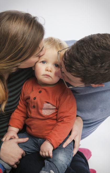 family baby kisses