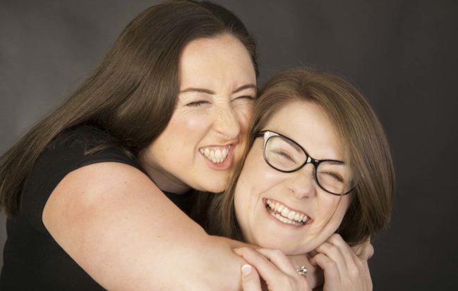 two sisters giving a big hug